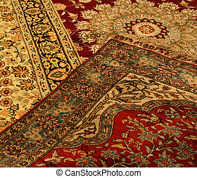 persian carpets - three very colourfull persian carpets on...
