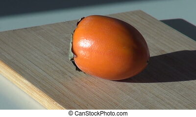 Persimmon fruit. Appetizing fresh vegetarian. sweet dessert