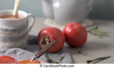 Persimmon fruit on rustic table in vintage style.