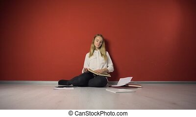 Persistent Young Student Girl Studying on Floor