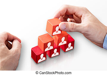 Person Building Blocks Of Team - Close-up Of A Person's Hand...