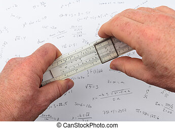 Two hands holding a slide rule or slipstick