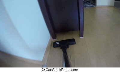 person clean dust under cupboard with vacuum cleaner. 4K -...