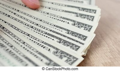 Person counting dollar banknotes in hands. Stitch of money. Rich man. A lot of dollars.