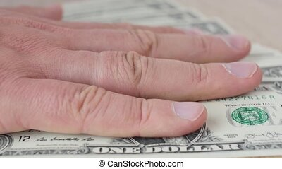 Person counting dollar banknotes in hands. Stitch of money. Rich man. A lot of dollars. Slow motion