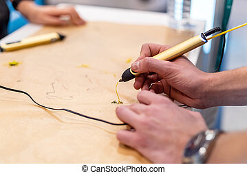 Person creating with 3D handle pen. Teenager using modern printing pen. Creative craft class