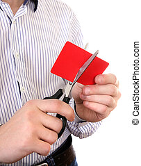Person cutting a Credit Card