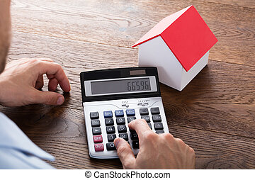 Person Doing Calculation Of House Model