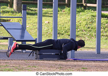 person doing gymnastics in the park
