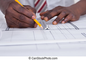 Person Drawing Blueprint - Close-up Of An African Architect ...