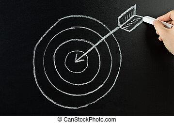 Person Drawing Dart And Arrow On Blackboard