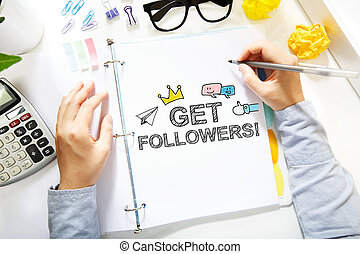 Person drawing Get More Followers concept on white paper