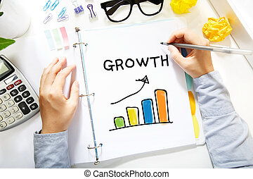 Person drawing Growth concept on white paper