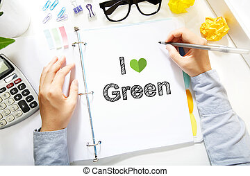 Person drawing I Love Green concept on white paper