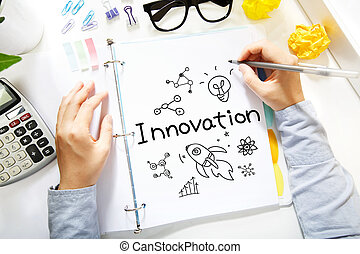 Person drawing Innovation concept on white paper