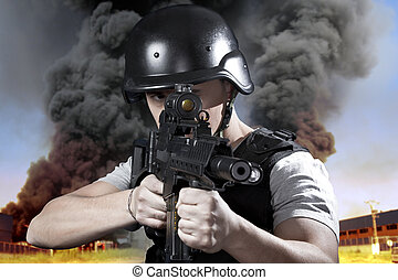 Person, explosion in an industry, armed police wearing...