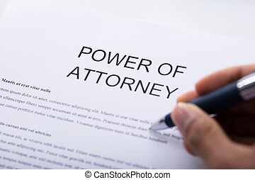 Person Filling Power Of Attorney Form - Close-up Of A...