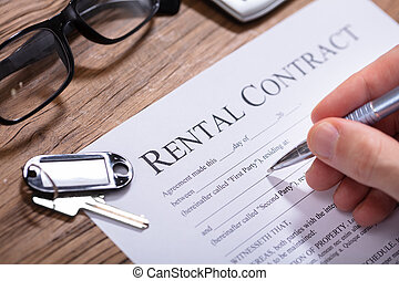 Person Filling Rental Contract Form