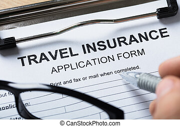 Person Filling Travel Insurance Form