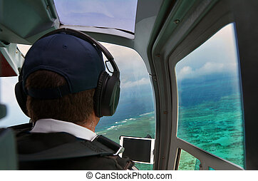 Person fly in helicopter above the Great Barrier Reef...