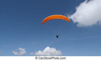 person flying on paraglide - adventure sport enjoy freedom...