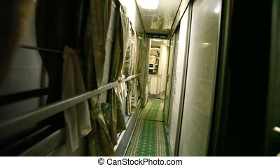 Person goes along the corridor of trains. - The person goes...