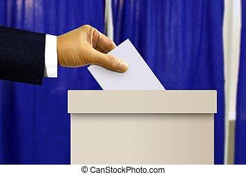 person hand casting a vote