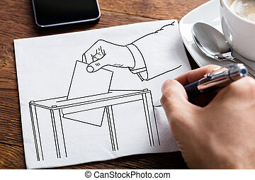 Person Hand Holding Pen On White Paper