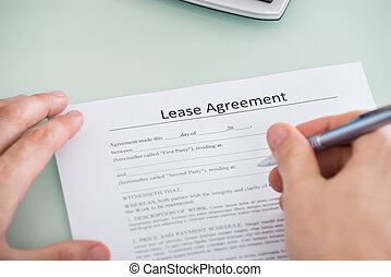 Person Hand Over Lease Agreement Form