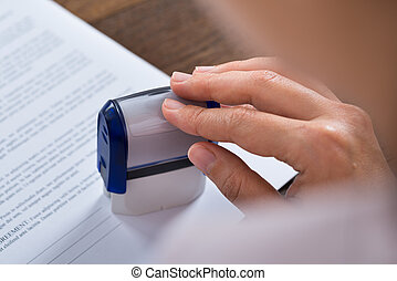 Person Hands With Stamper And Document
