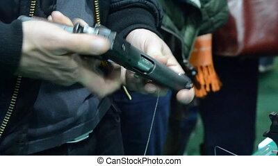 Person holding a gun in hand close-up. Firearms gun...
