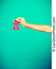 Person holding keys with pendant in house shape - Household...