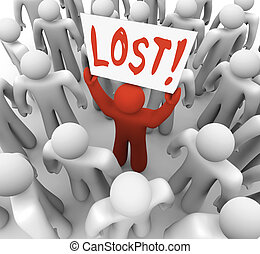 Person Holding Lost Sign in Crowd - A red person stands out...