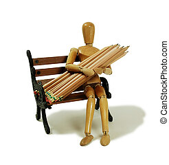 Wooden model representing a person holding wooden pencils used for drawing