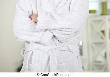 Person in bathrobe