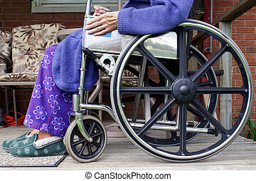 Person in Wheelchair - The lower half of an elderly person...