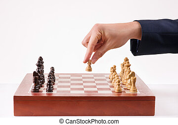 Person making first chess move.