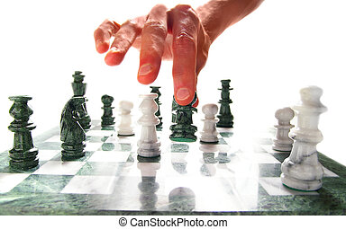 person moving a chess piece on the board, over white