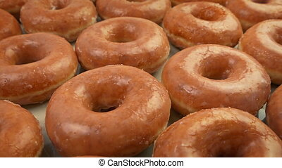 Person Picks Up Donut From Counter - Moving slowly past...