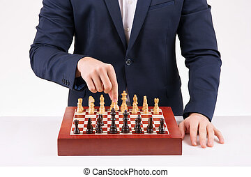 Person playing chess game.
