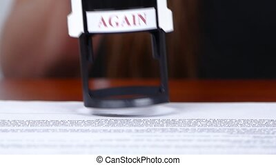 Person processes the documents and puts the mark of the...