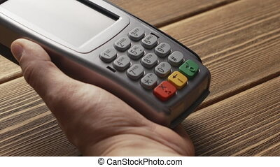 Person pushing the button and swipe credit card payment on...