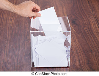 Person Putting Ballot In Box