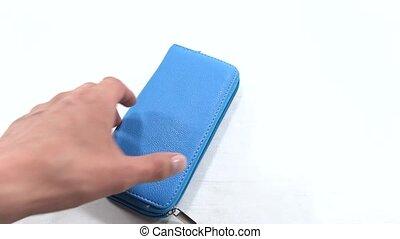 person seeking money in blue wallet