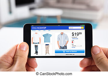 Person Shopping Online On Smartphone