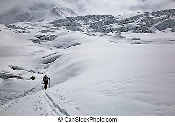 person ski touring in the swiss alps