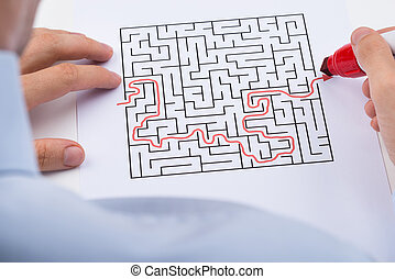 Person Solving Maze Puzzle