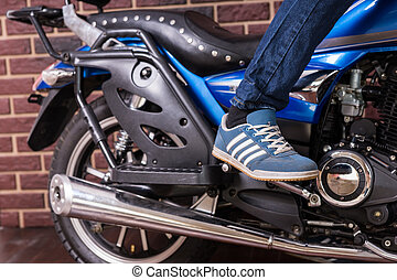 Person Standing on Foot Pegs of Cruiser Motorcycle