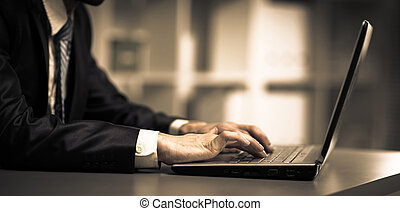 Person Typing on a modern laptop