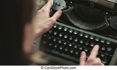 Person typing on old typewriter - Cropped shot of person...
